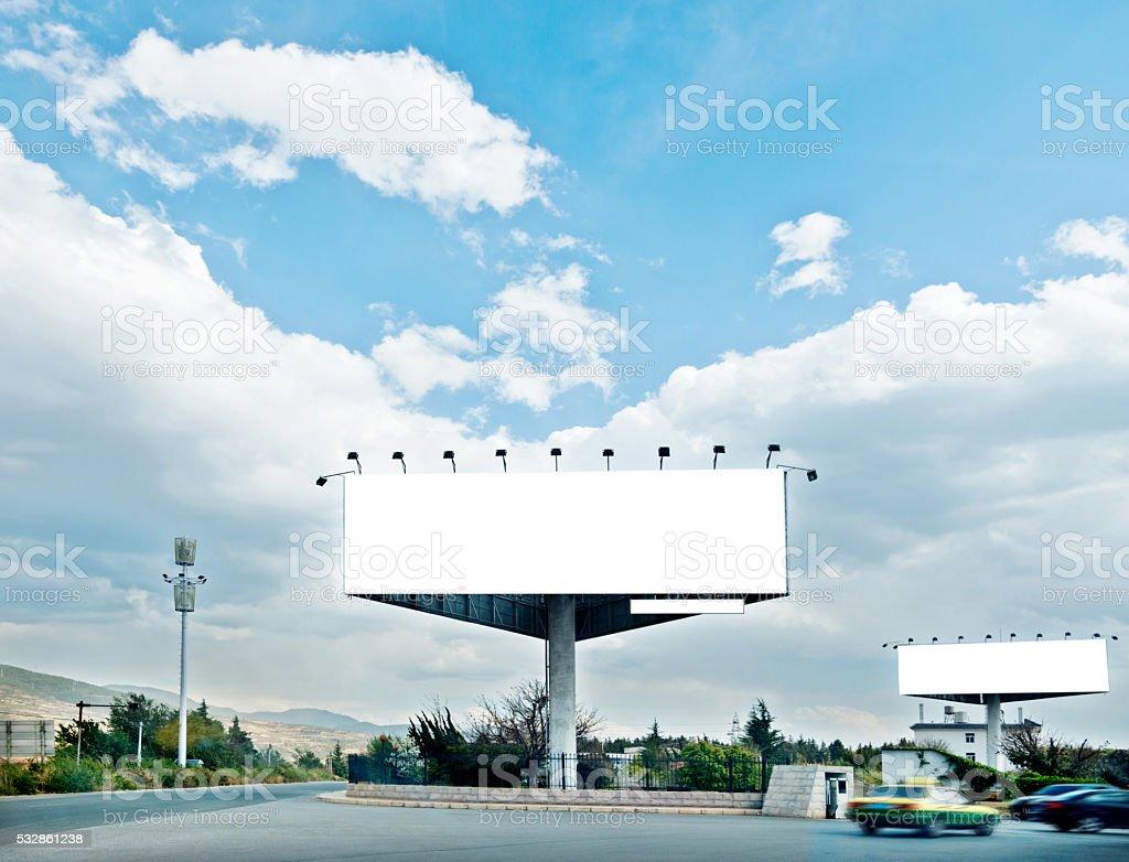 Blank advertising board on street stock photo