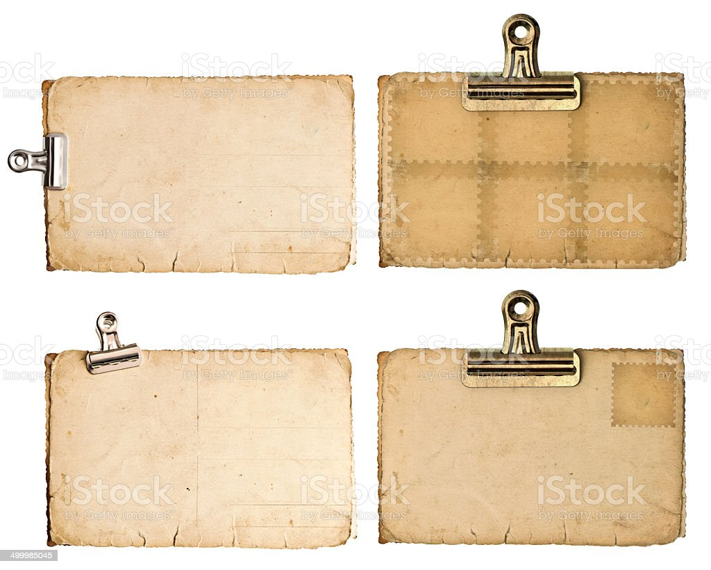 blank aged paper sheets with clip isolated on white stock photo