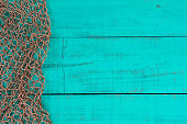 Blank antique teal blue wooden sign with fish net border