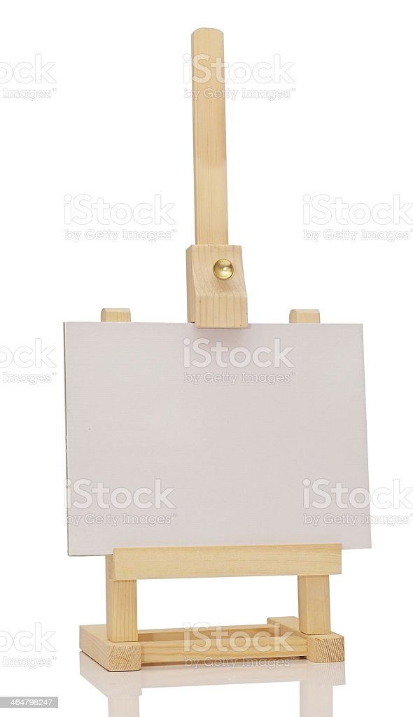 Blank art board, wooden easel, front view, isolated on white stock photo