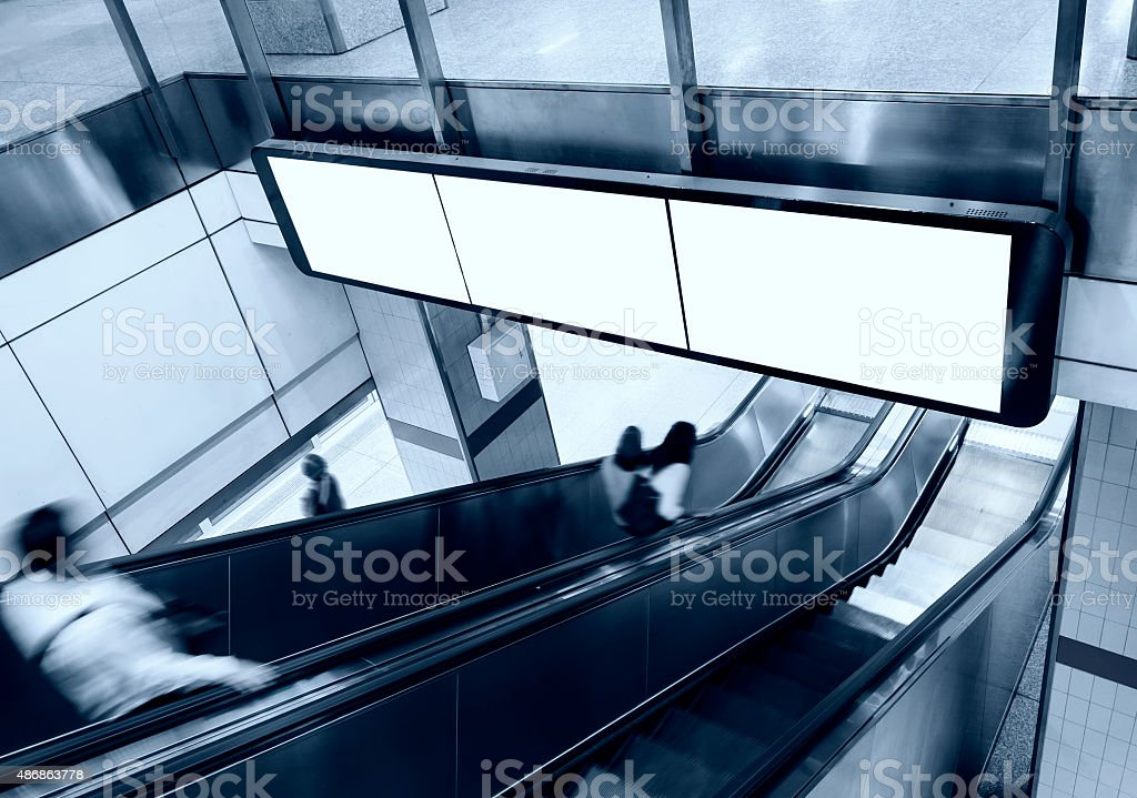 Blank Banner Billboard Display with escalator and people stock photo