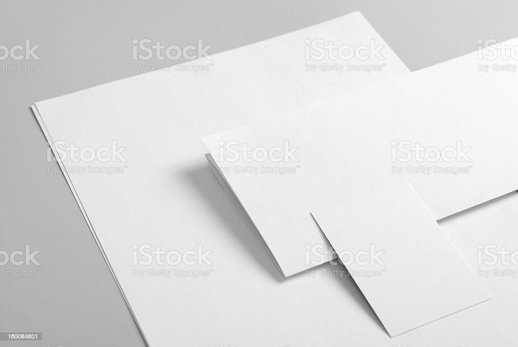 Blank basic stationary folded on gray background stock photo