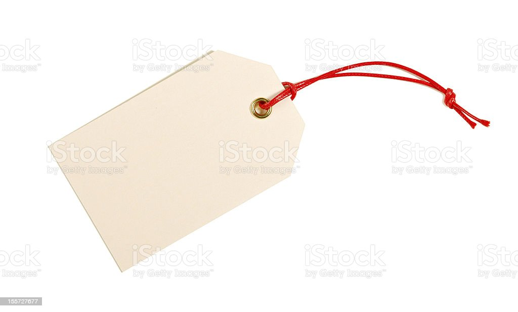 A blank beige label with a red string on a white background  stock photo