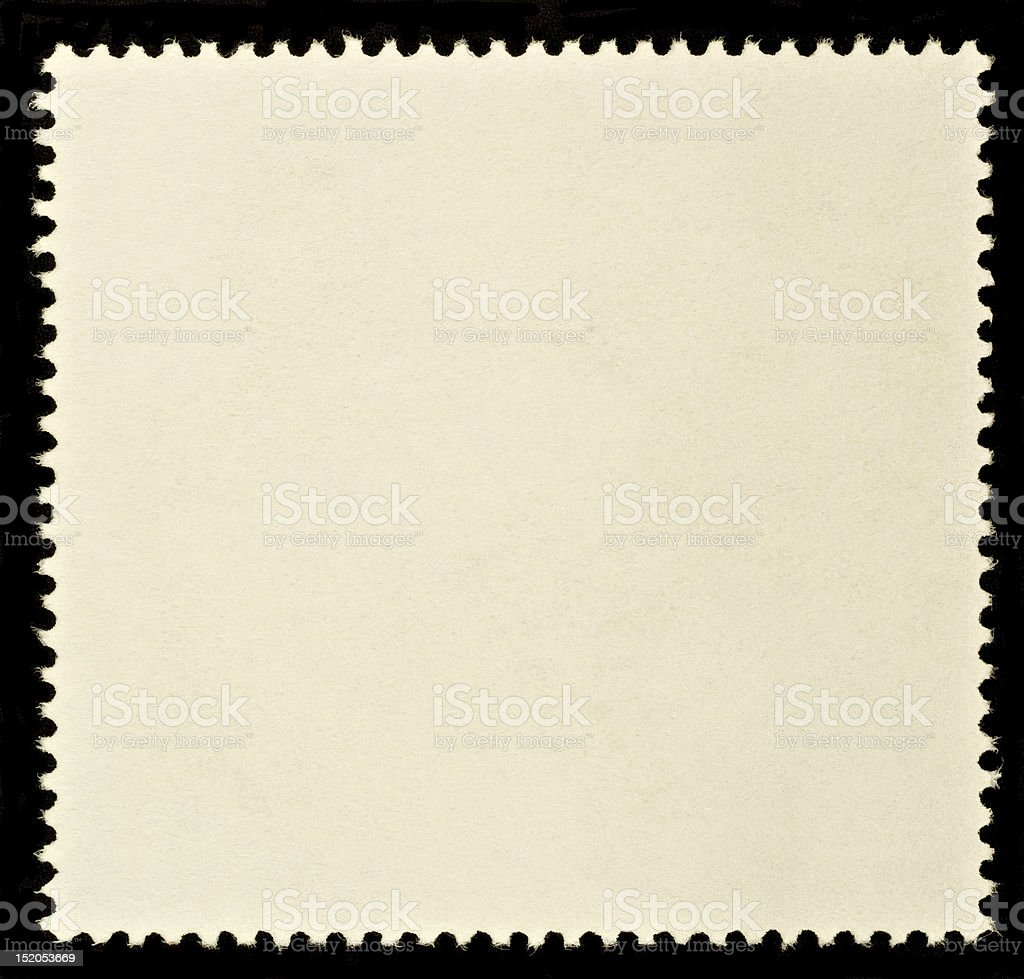 A blank biege square postage stamp with jagged edges stock photo