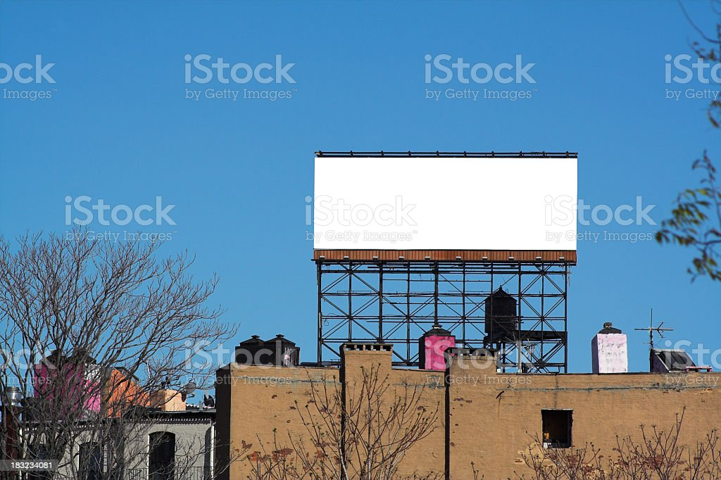 Blank Billboard Above City Apartment stock photo