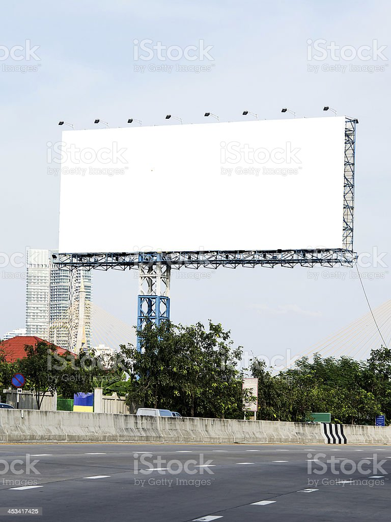Blank billboard against blue sky with clouds. royalty-free stock photo