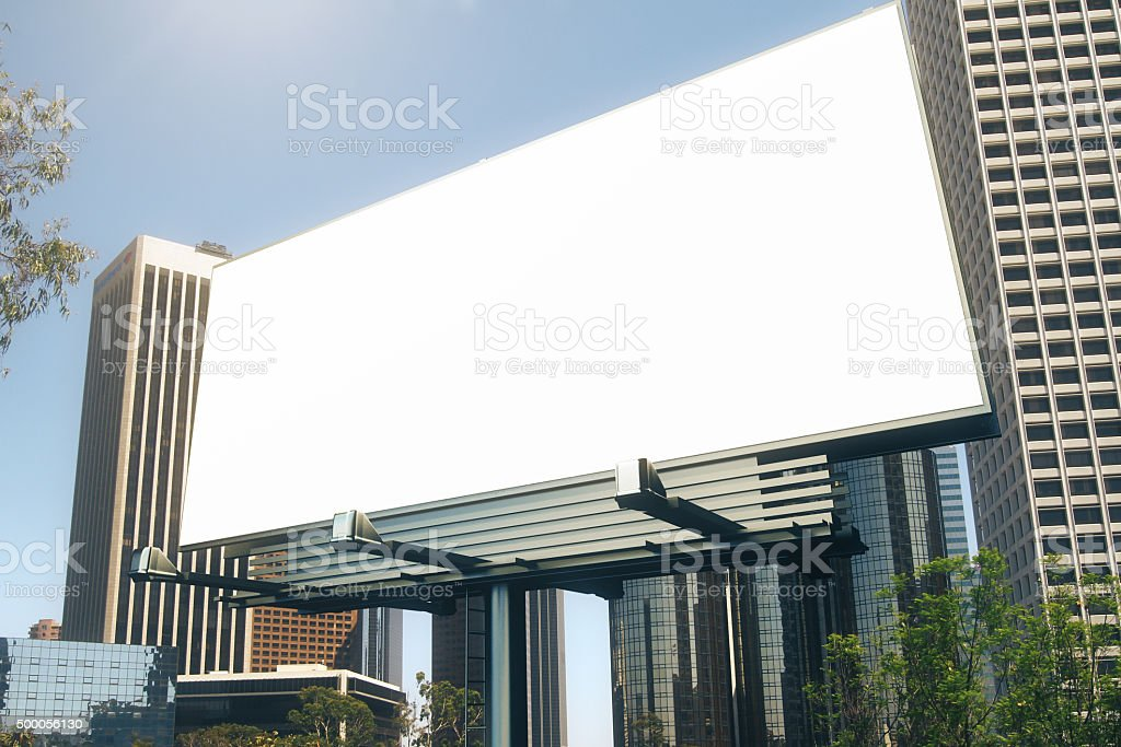 Blank billboard at skyscrapers backgound, mock up stock photo