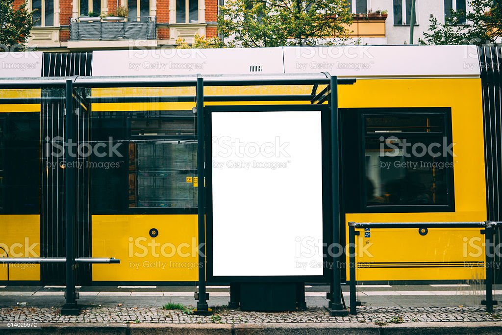 Blank billboard at tram station stock photo
