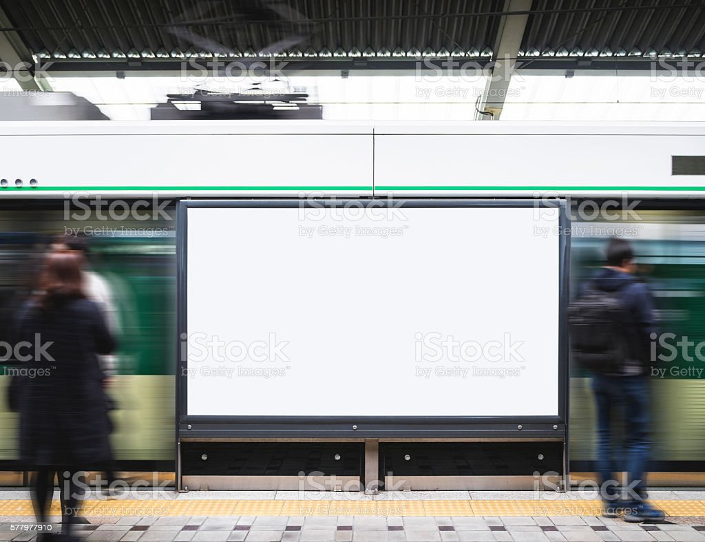 Blank Billboard Banner in Subway station with blurred people stock photo