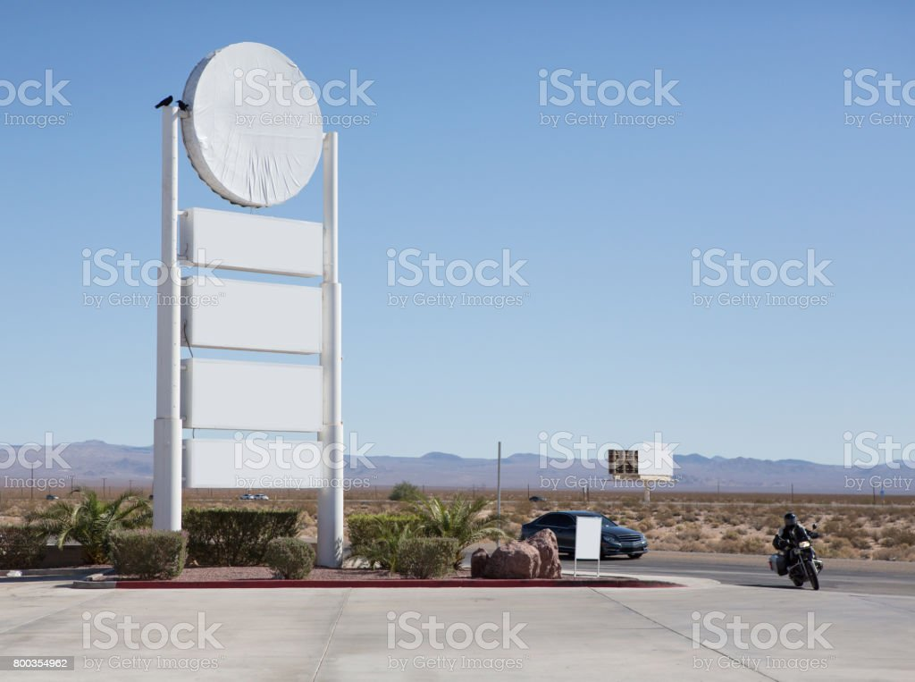 blank billboard beside the highway with blue sky stock photo