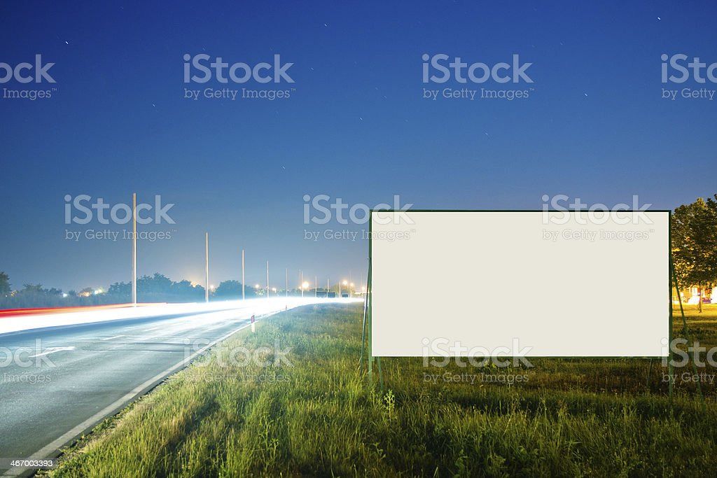 Blank billboard by the road stock photo