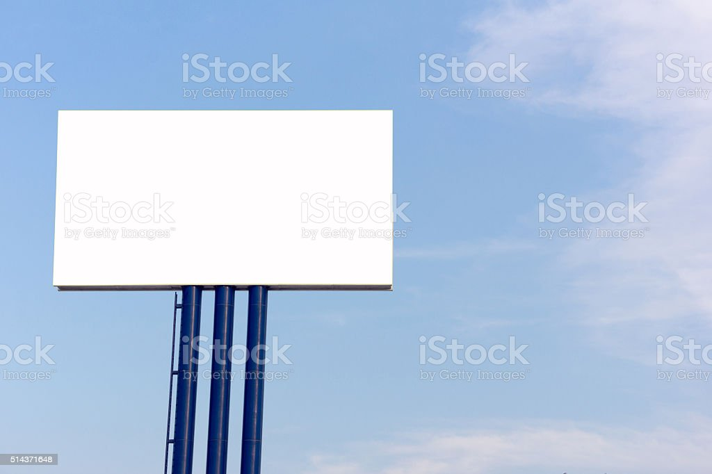 blank billboard for new advertisement against blue sky stock photo