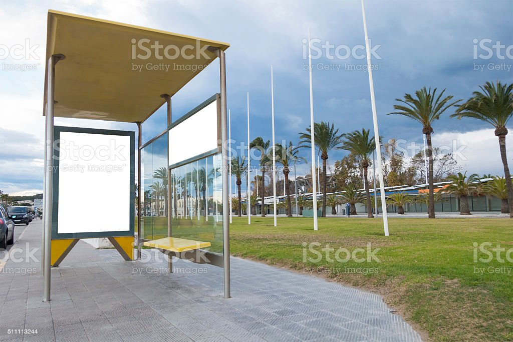 Blank billboard in a bus stop stock photo