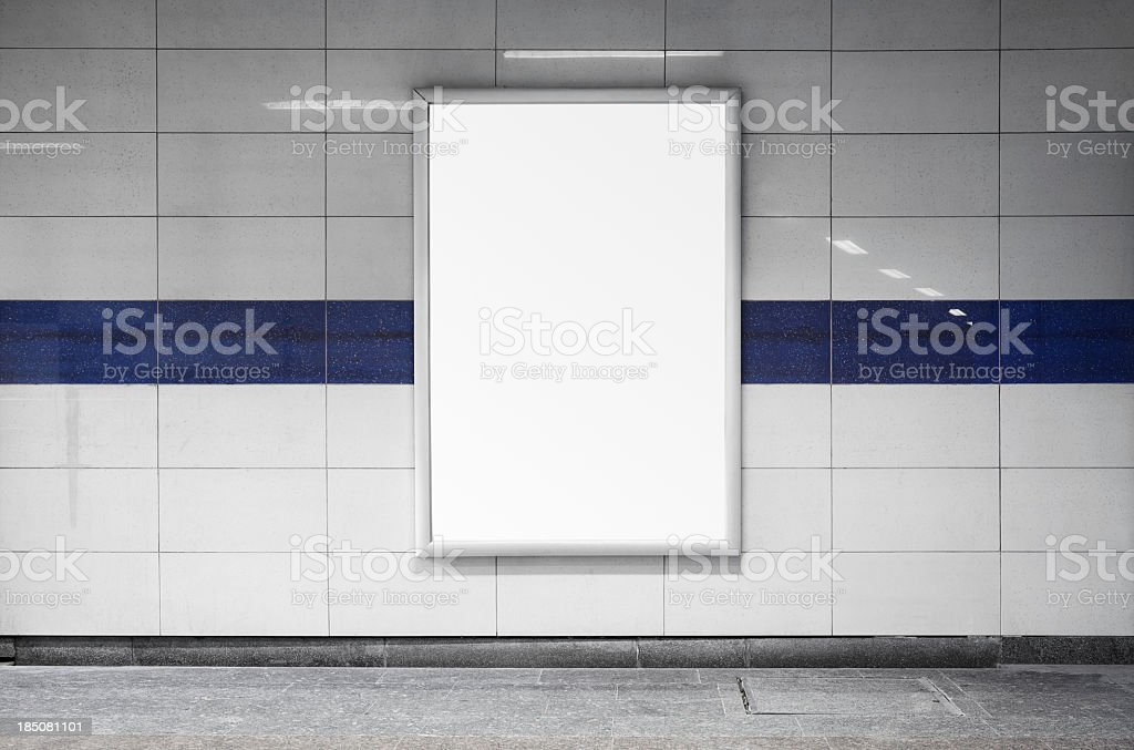 Blank billboard in a subway station wall stock photo