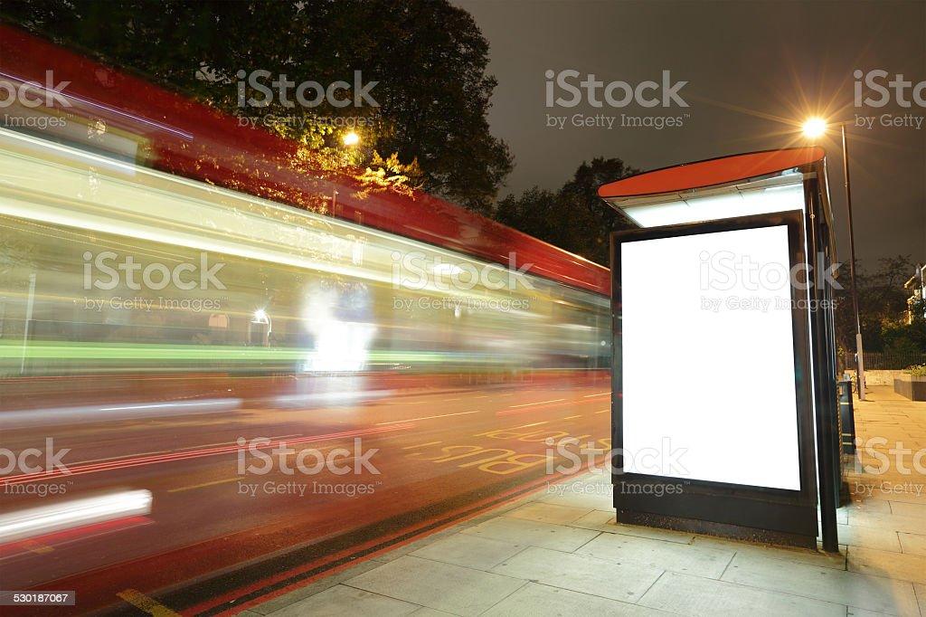 Blank billboard in bus stop stock photo