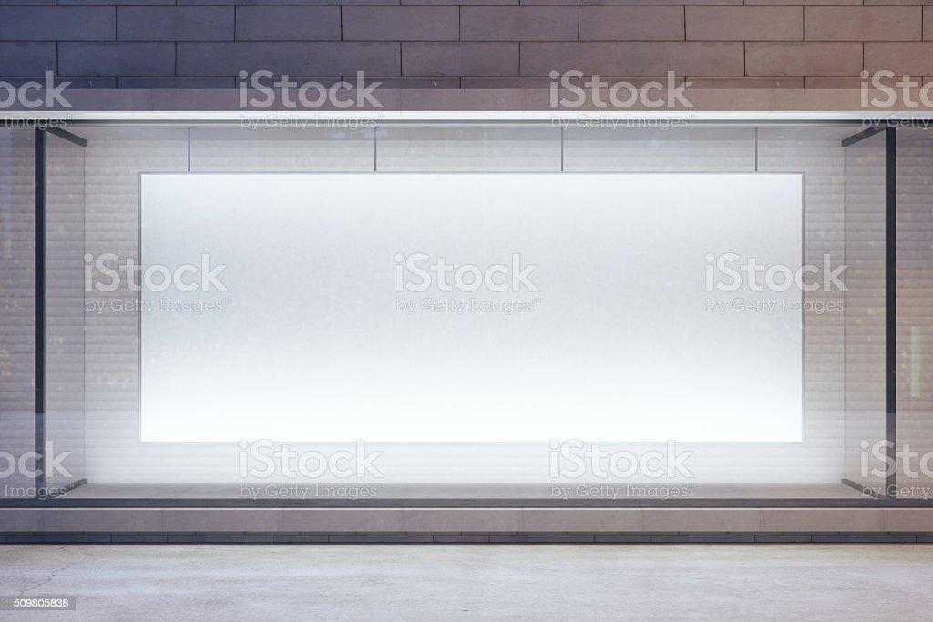 Blank billboard in showcase on evening street, mock up stock photo