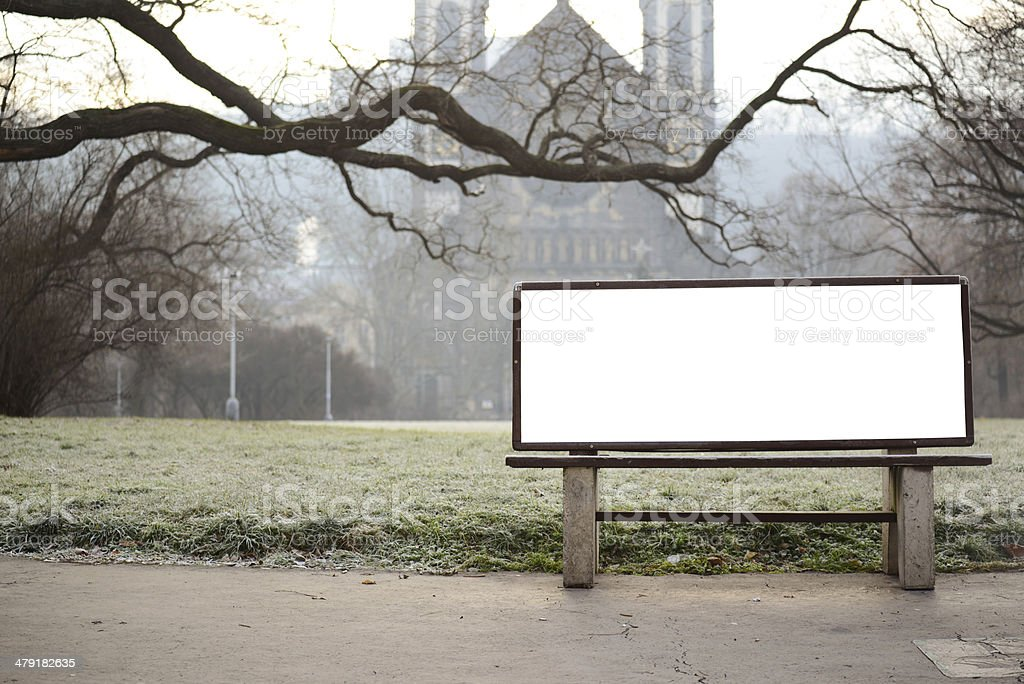 Blank billboard on bench at city park stock photo