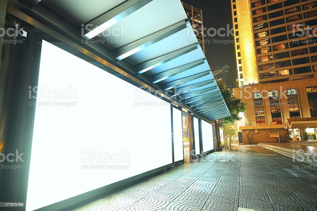 Blank billboard on bus stop at night royalty-free stock photo