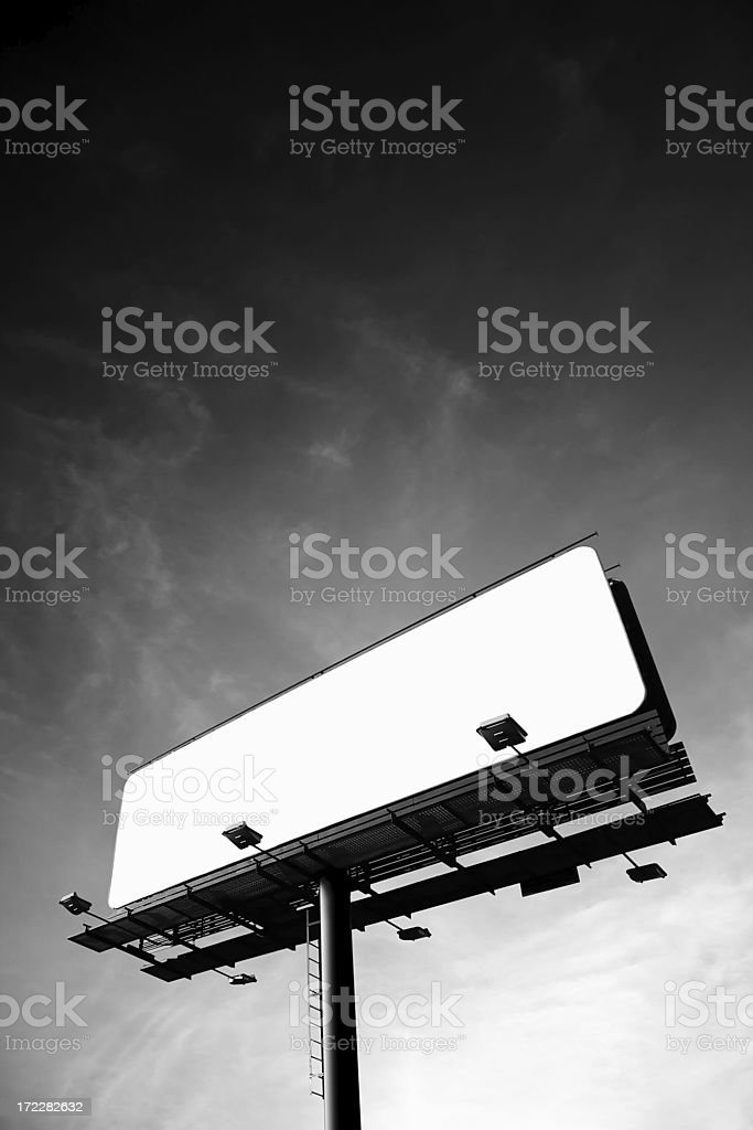 Blank billboard on cloudy sky, just add your text stock photo