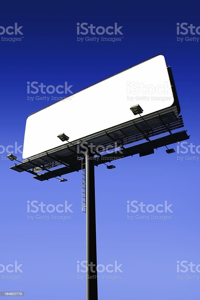 Blank billboard on cloudy sky, just add your text royalty-free stock photo