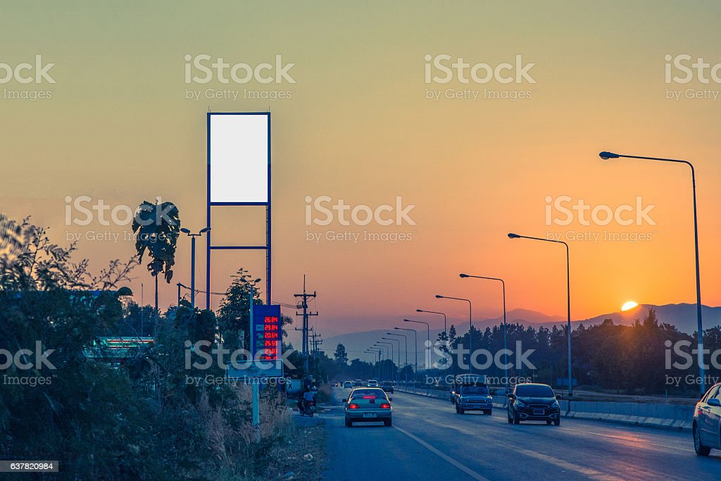Blank billboard on Petrol station and Gas station at sunset stock photo