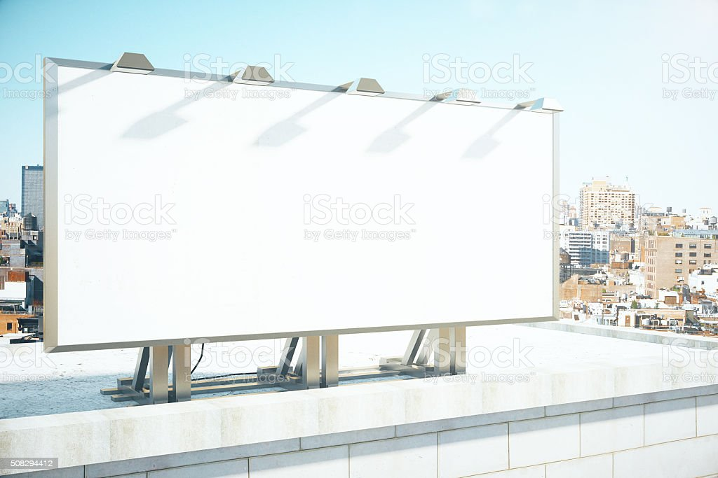Blank billboard on the roof of building stock photo