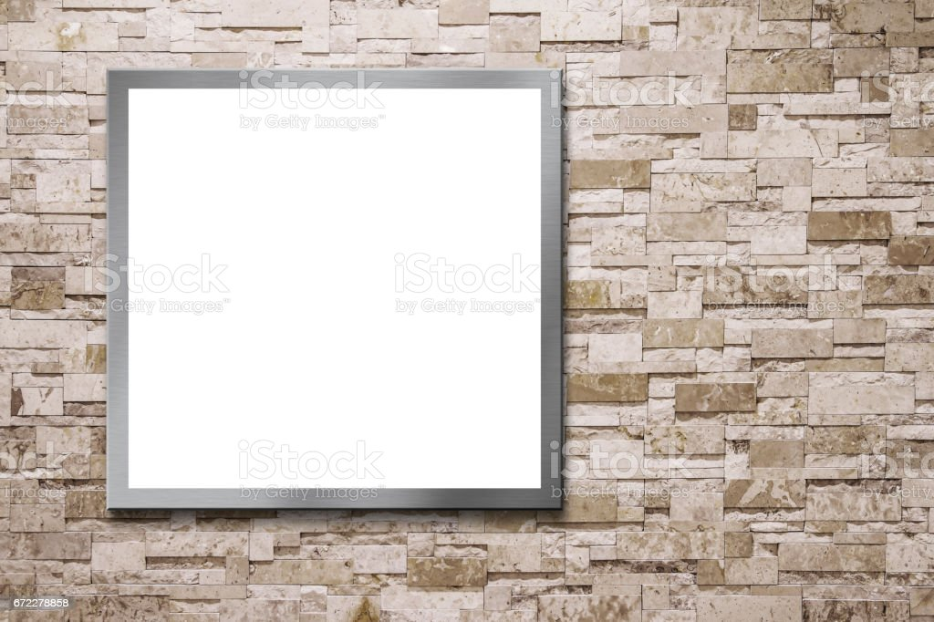 Blank billboard on the stone wall stock photo