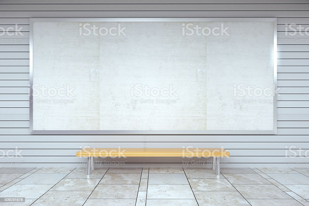 Blank billboard on the wall and wooden bench stock photo