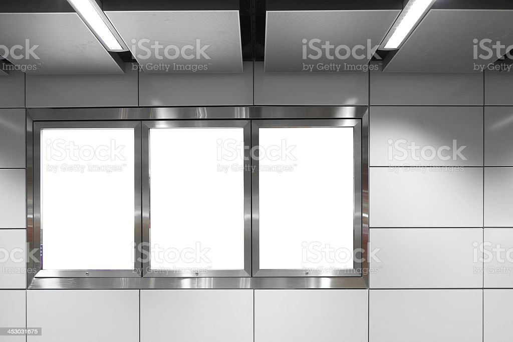 blank billboard on white wall stock photo