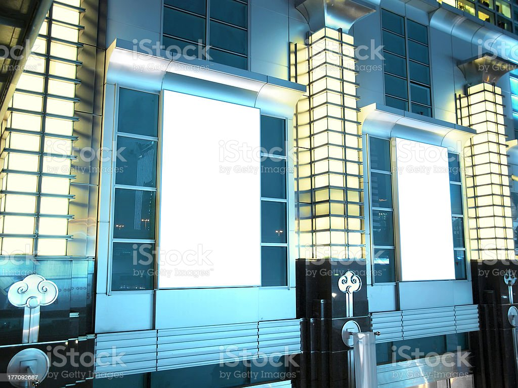 Blank billboard outside building royalty-free stock photo