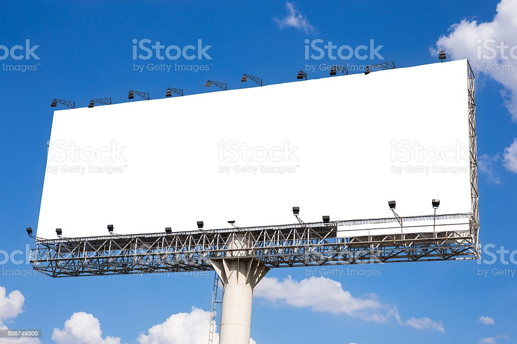 Blank billboard ready for new advertisement with blue sky background stock photo