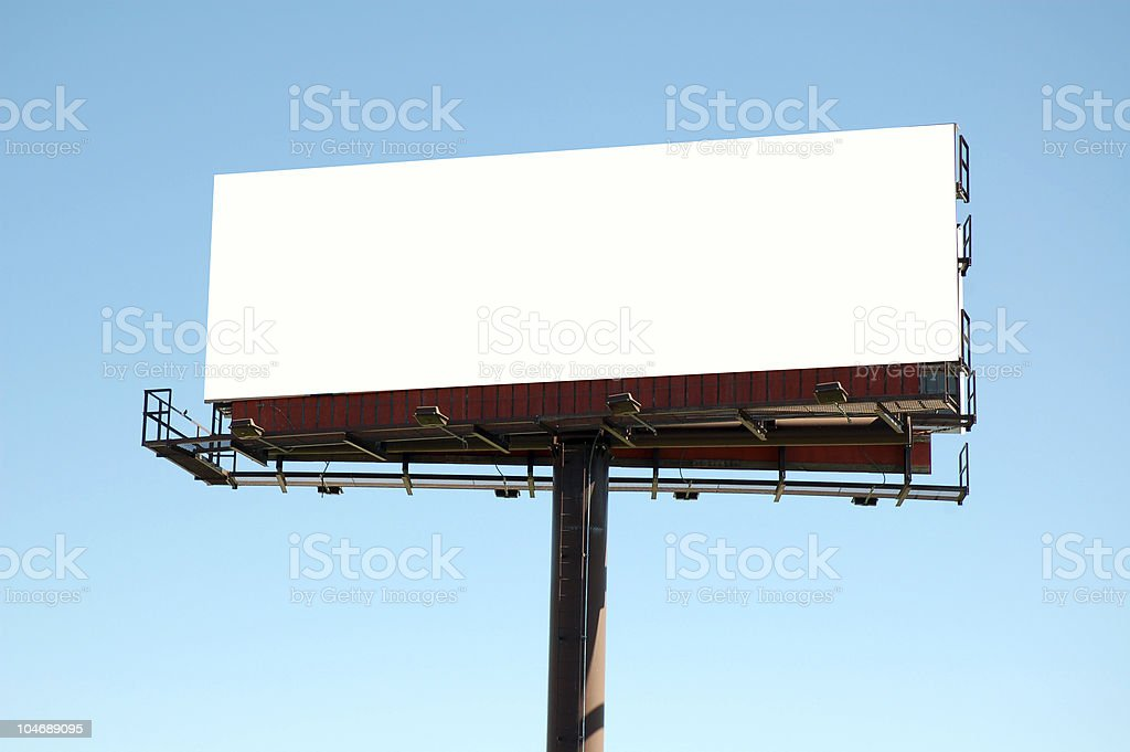 Blank billboard sign against a clear, blue sky royalty-free stock photo