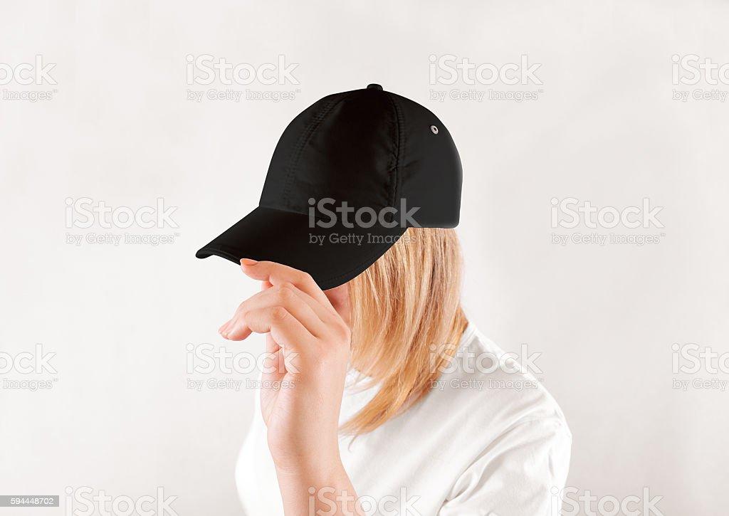 Blank black baseball cap mockup template, wear on women head stock photo