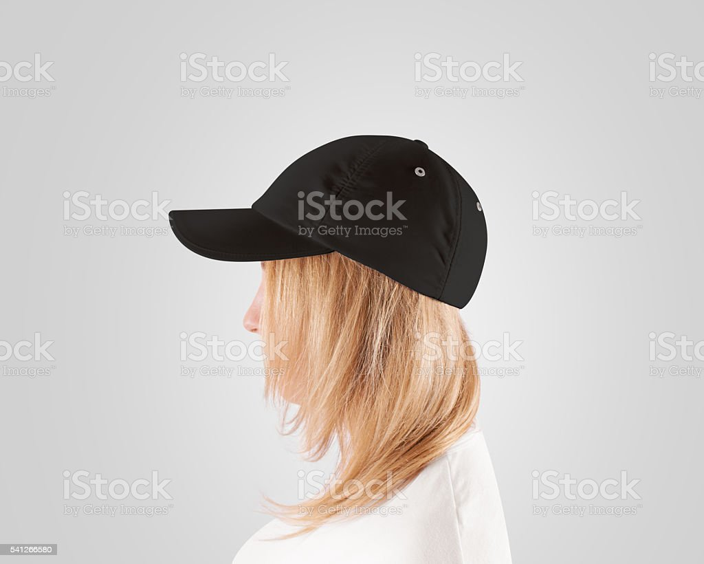 Blank black baseball cap mockup template, women head, profile, isolated stock photo