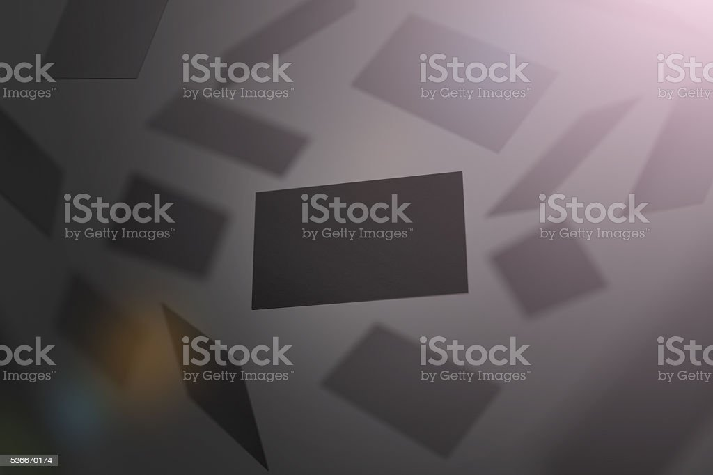 Blank black business cards falling stock photo