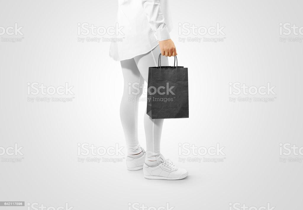 Blank black craft paper bag design mockup holding hand stock photo