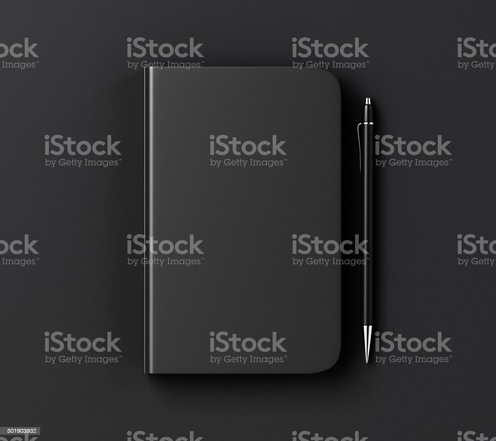 Blank black diary cover and pen on black table stock photo