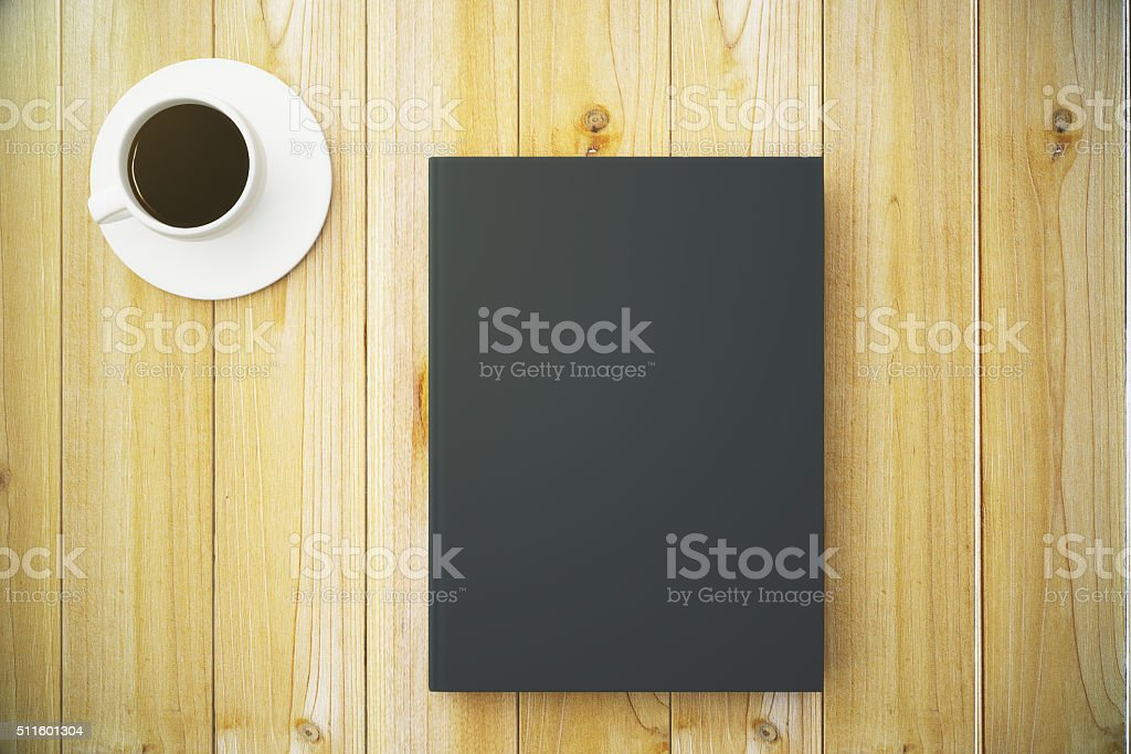 Blank black diary cover with cup of coffee stock photo