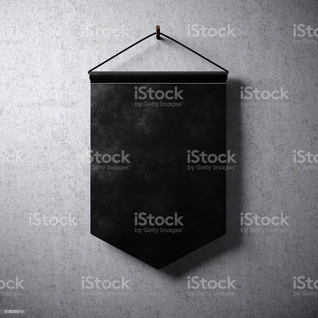 Blank black pennant hanging concrete wall. Ready for your business stock photo