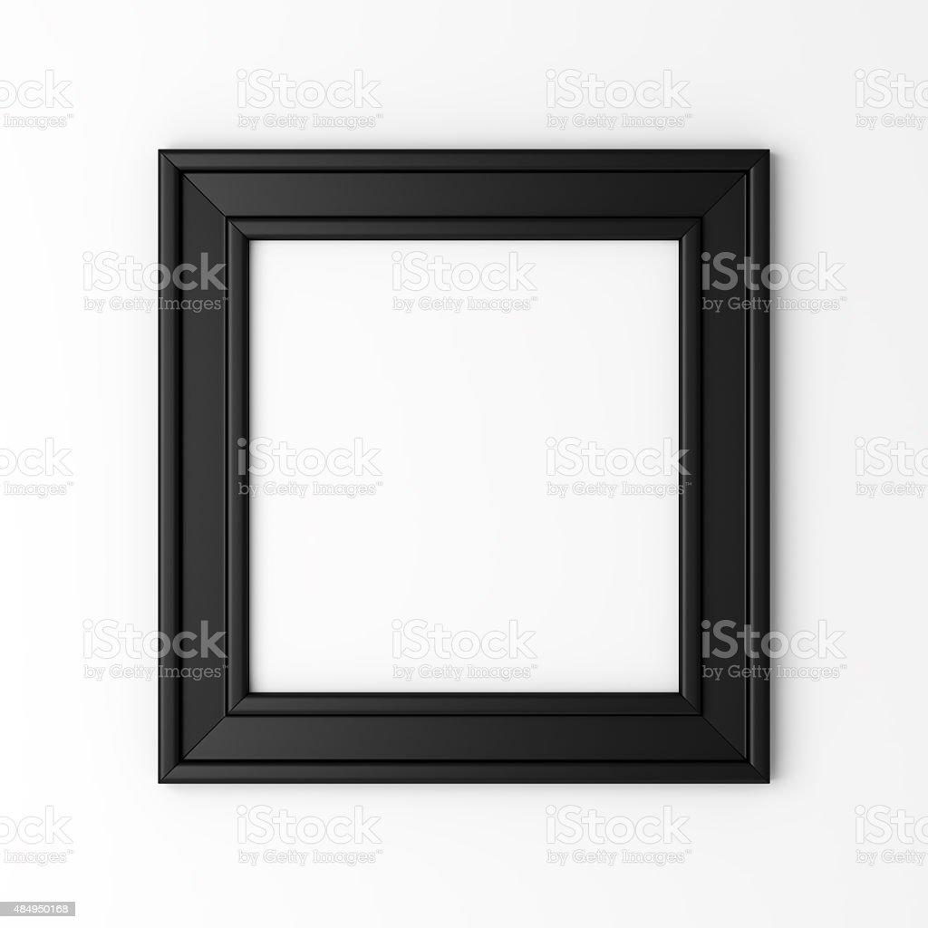 blank black photo frame on white wall stock photo