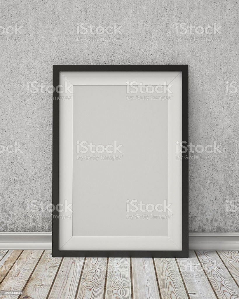 blank black picture frame on an old wall and vintage stock photo