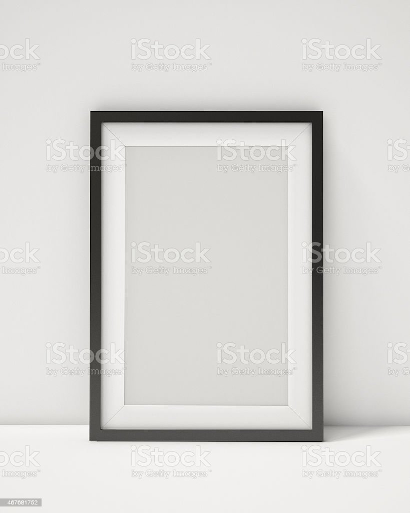 blank black picture frame on the white interior background stock photo