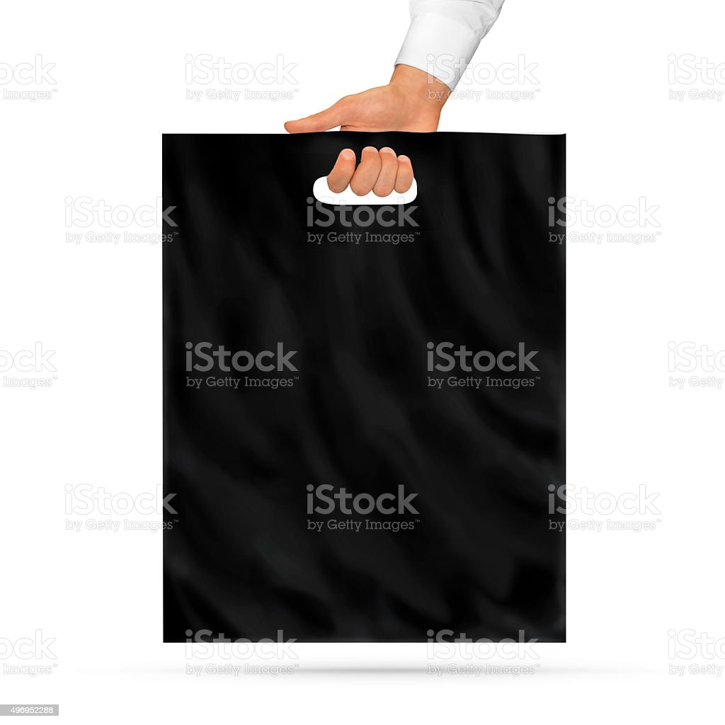 Blank black plastic bag mock up holding in hand. stock photo