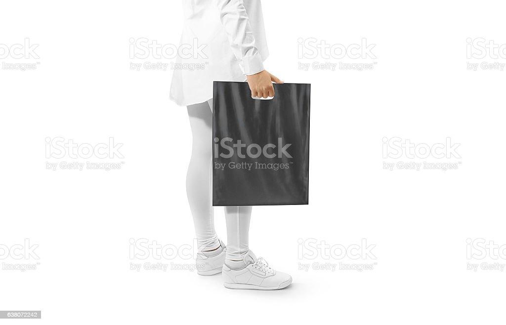 Blank black plastic bag mockup holding hand stock photo