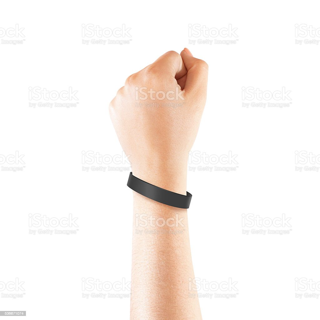 Blank black rubber wristband mockup on hand, isolated stock photo