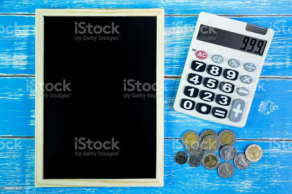 Blank blackboard and calculator.Template mock up stock photo