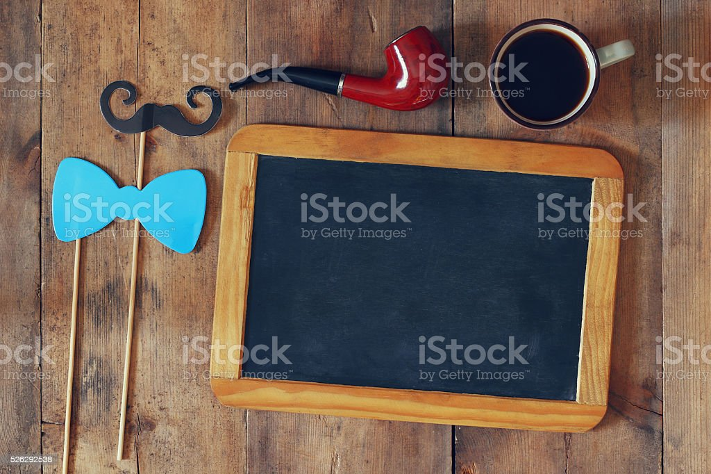 blank blackboard and composition of man's accessories stock photo