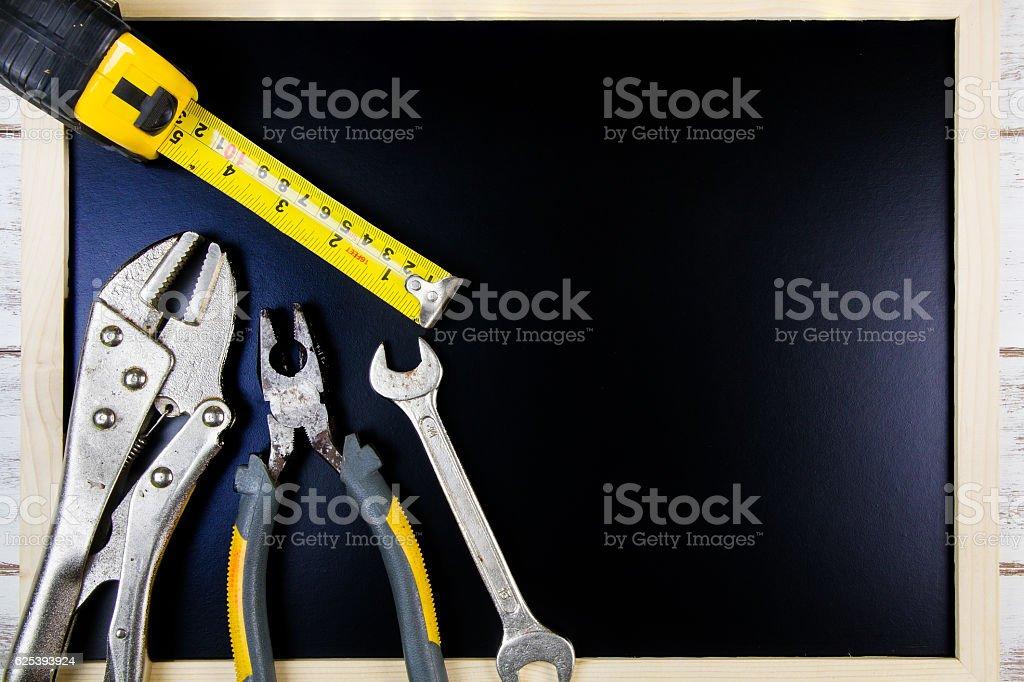 Blank blackboard and Set of repair hand tools. stock photo