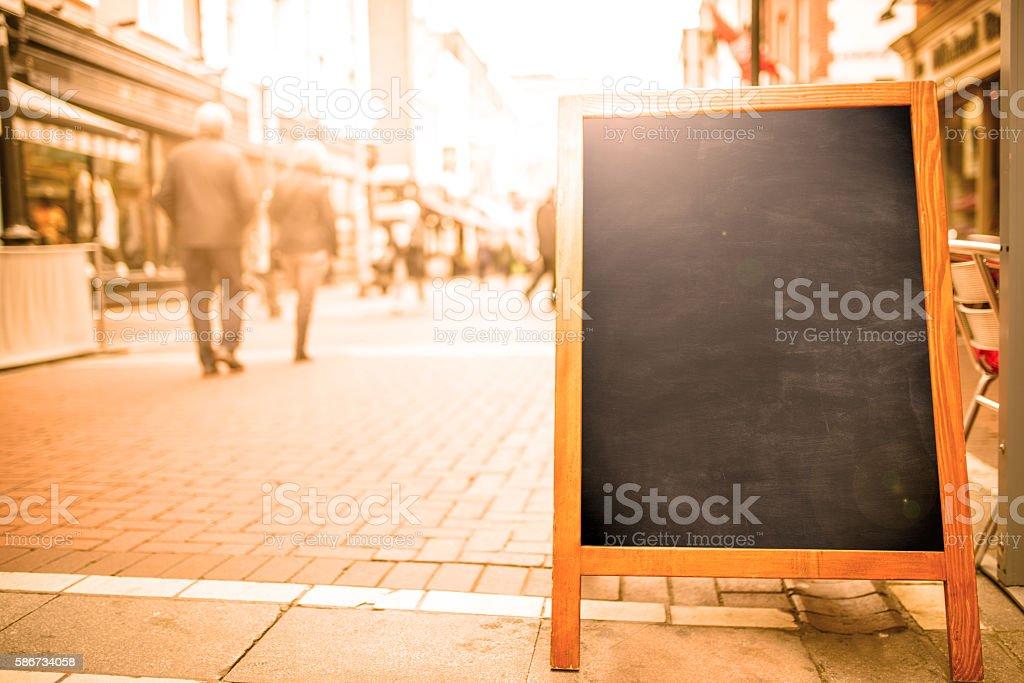 blank blackboard street sign stock photo