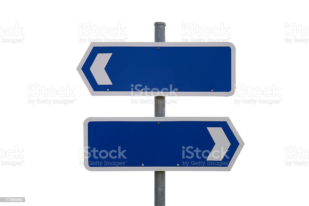 Blank blue and white signs pointing in different directions stock photo